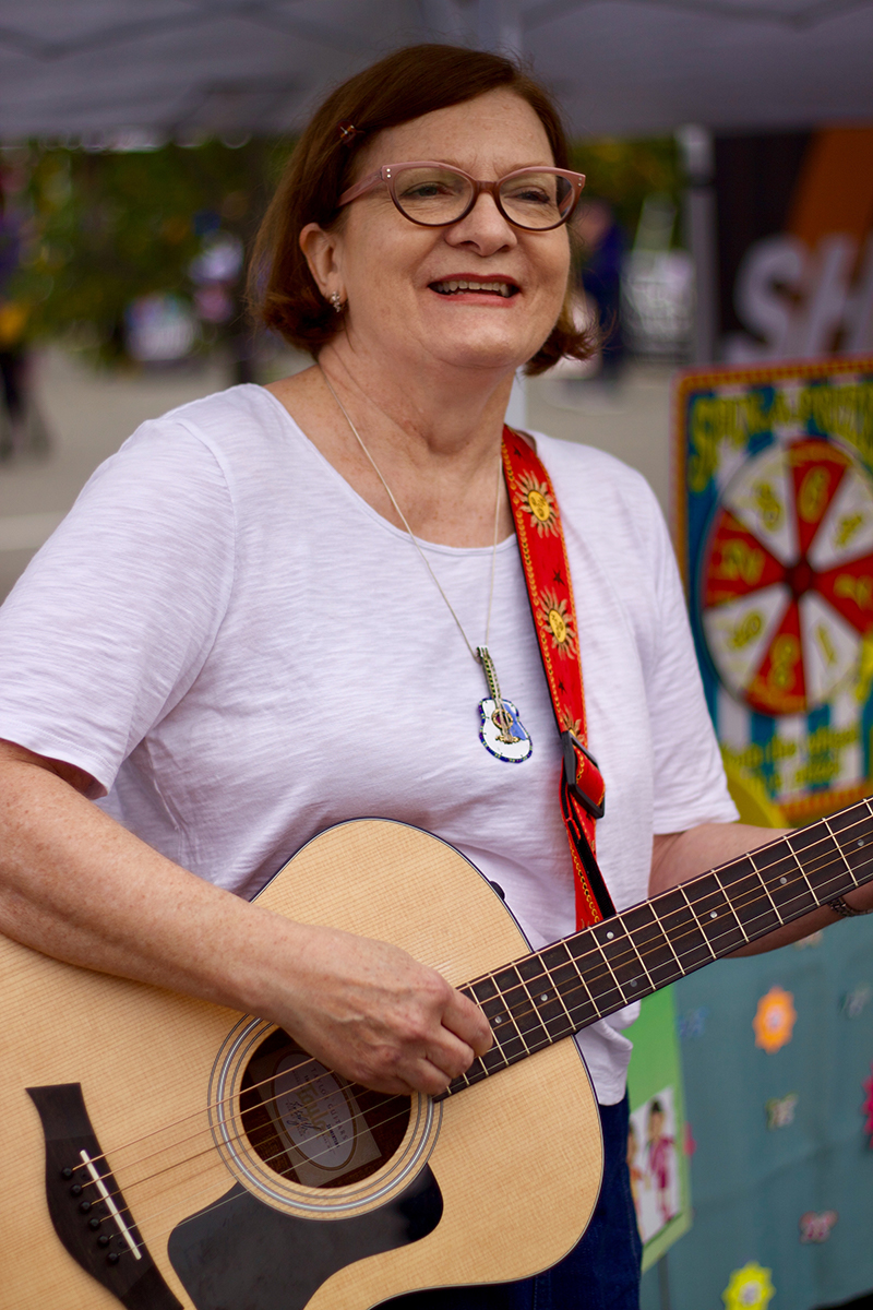A nice lady from Safari Kids plays guitar for the little ones at SterlingFest