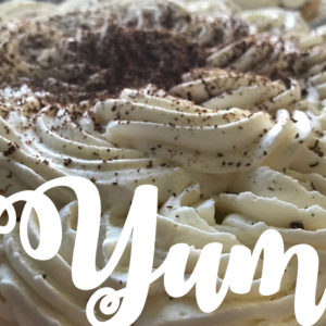 """A gorgeous pie with """"Yum"""" calligraphy text over it"""